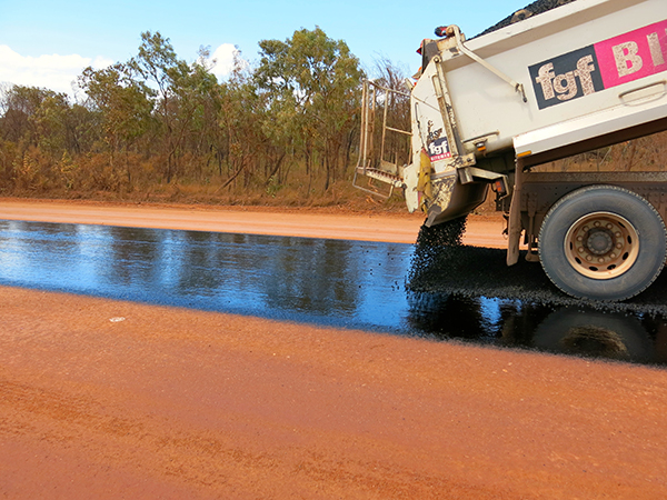 Bitumen being sprayed on the Sourayas Hill section