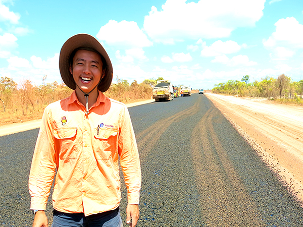 RoadTek's William Chou standing on new seal on the Sourayas Hill section