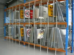 Numerous traffic signs stored inside a satellite depot